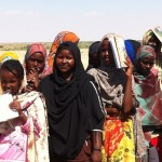 Women waiting for water at IDP camp.